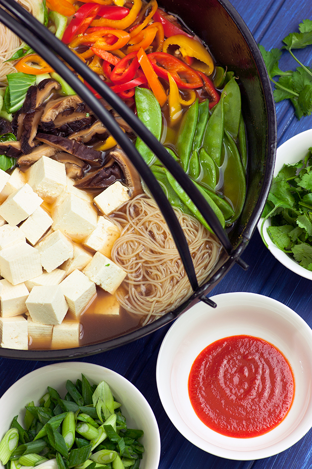 We've been on a shabu-shabu-style one-pot Asian noodles kick lately. Load up with all veggies or add your favorite protein. So easy and in one pot!